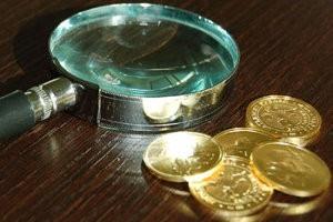 Как определить подлинность монеты?